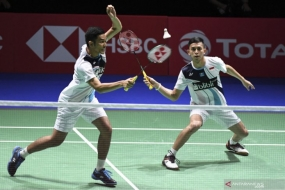 The Indonesia's men-doubles pair Fajar Alfian (left) and Muhammad Rian Ardianto (right) attempt to return the shuttlecock to their fellow Indonesian athletes, Hendra Setiawan/Mohammad Ahsan at the semifinal round of the 2019 BWF World Championship in St. Jakobshalle, Basel, Switzerland, Saturday (Aug 24, 2019).