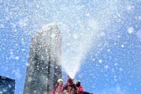 Firefighters spray disinfectant in the Thamrin business district in Jakarta on Tuesday