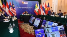 Vietnam's Deputy Prime Minister and Foreign Minister Pham Binh Minh chair an ASEAN video meeting
